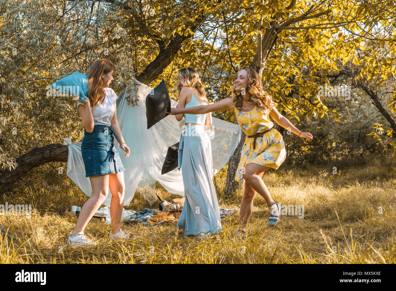 Group of girls friends making picnic outdoor. - Stock Image