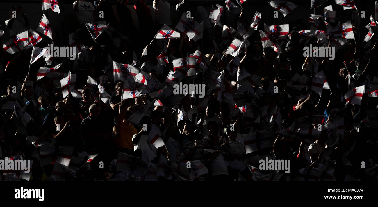 London, UK. 2nd June, 2018. English supporters wave flags ahead of the International Friendly Football match between England and Nigeria at Wembley Stadium in London, Britain on June 2, 2018. England won 2-1. Credit: Han Yan/Xinhua/Alamy Live News Stock Photo