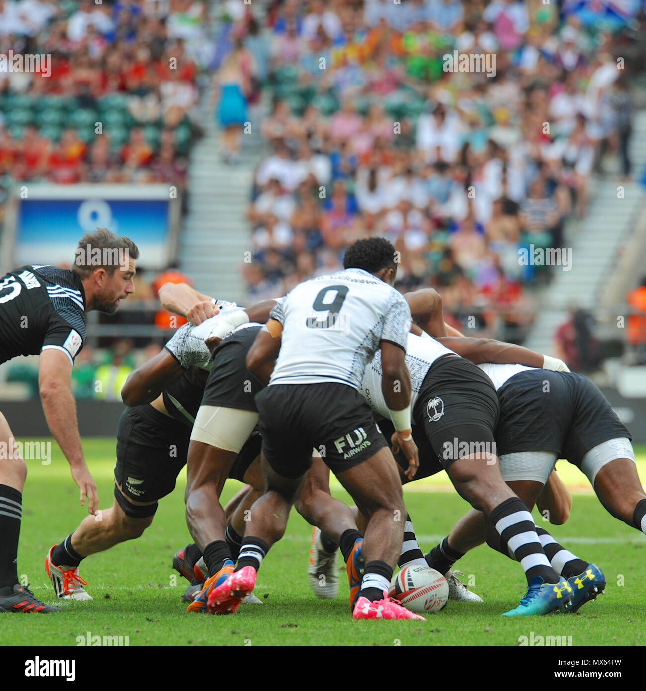Twickenham Stadium, London, UK. 2nd Jun, 2018. Players locked into a scrum during the Fiji V New Zealand rugby sevens match at Twickenham Stadium, London, UK.  The match took place during the penultimate stage of the HSBC World Rugby Sevens Series. The series sees 20 international teams competing in rapid 14 minute matches (two halves of seven minutes) across 11 different cities around the world - the finale will be in Paris in June. Credit: Michael Preston/Alamy Live News - Stock Image