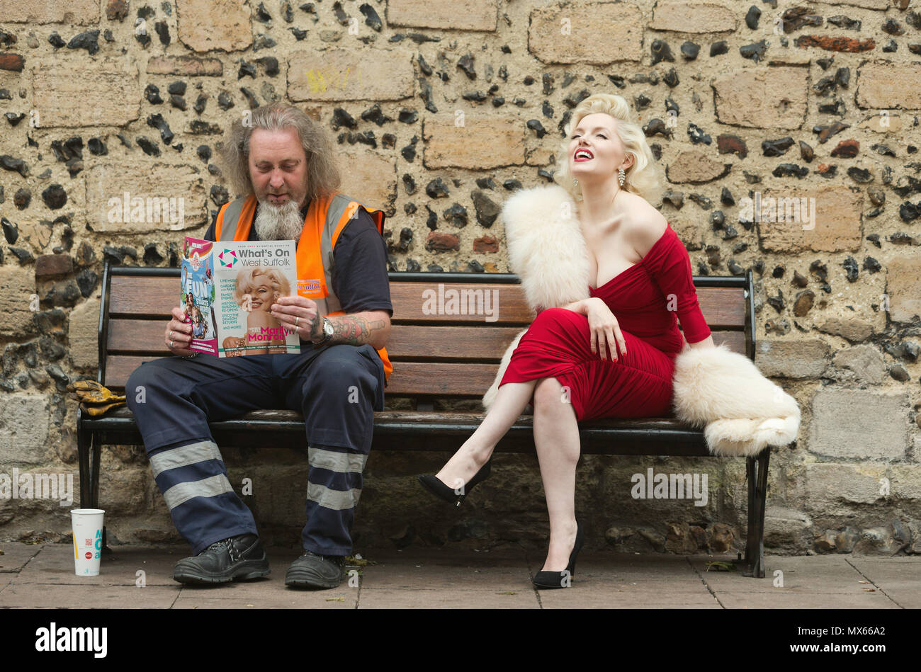 Bury St Edmunds, UK. 2nd Jun, 2018. Graham Silcock reads about the latest exhibition unaware he is seated beside the world's leading Marilyn Monroe tribute artist, Suzie Kennedy before she opened the 'Timeless' exhibition at Moyses Hall, Bury St Edmunds, which includes stunning images from Marilyn Monroe's very earliest days as a model, behind-the-scenes captures from her film-work, breathtaking location and studio work and emotive candid images that showcase her true personality in a unique and engaging way. Credit: Keith mindham/Alamy Live News Stock Photo
