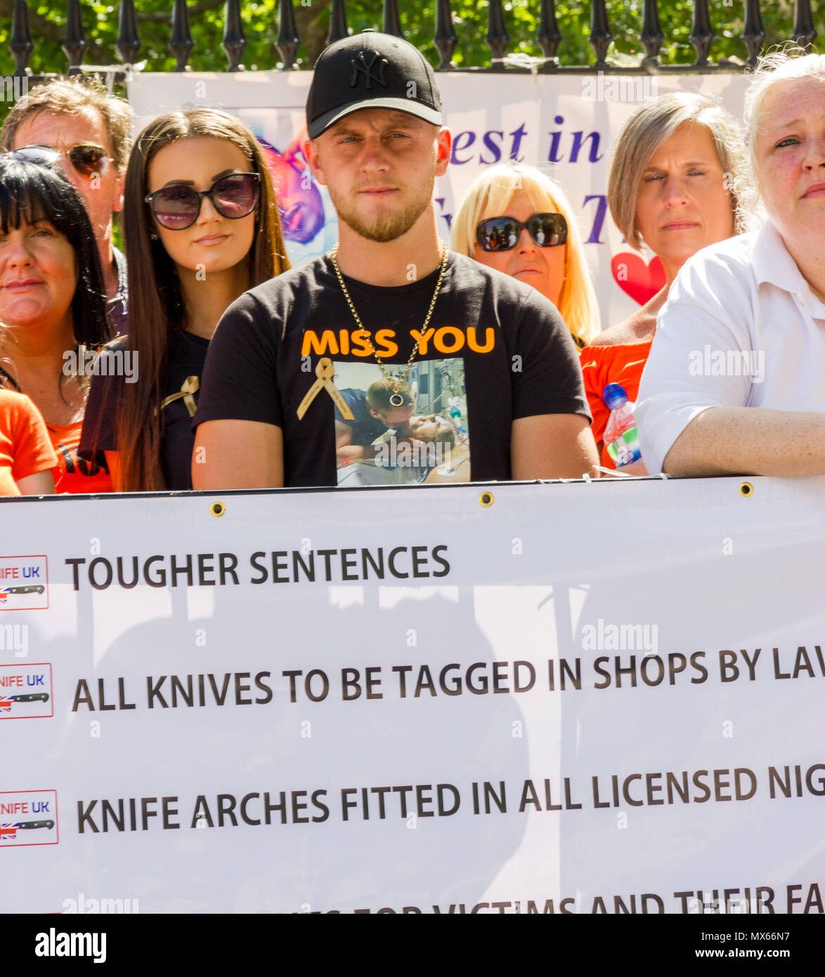 Downing Street, London, UK. 3rd June 2018. This morning, families of knife crime victims, their friends and supporters gather opposite 10 Downing street, prior to presenting The British Prime Minister Theresa May with a petition demanding action to curb the unacceptable levels of Knife Crime in London and across the United Kingdom. Credit: Alan Fraser/Alamy Live NewsStock Photo