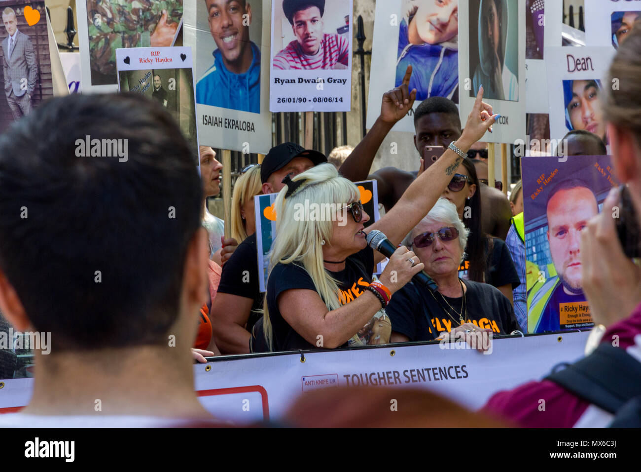 Downing Street, London, UK. 3rd June 2018. This morning, families of knife crime victims, their friends and supporters gather opposite 10 Downing street, prior to presenting The British Prime Minister Theresa May with a petition demanding action to curb the unacceptable levels of Knife Crime in London and across the United Kingdom. Credit: Alan Fraser/Alamy Live News - Stock Image