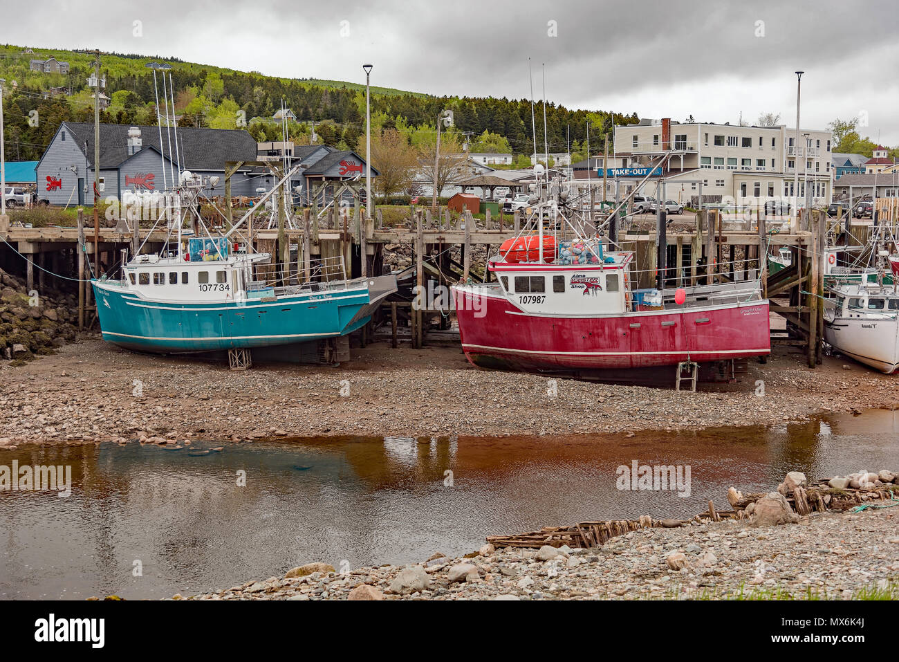 Alma, New Brunswick lobster fishing boats in harbour at low