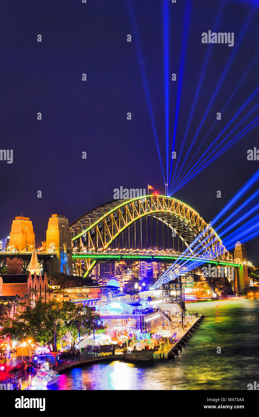 The Sydney Harbour bridge arch during Vivid Sydney light show and festival illuminated with bright blue laser beams in dark night sky. - Stock Image