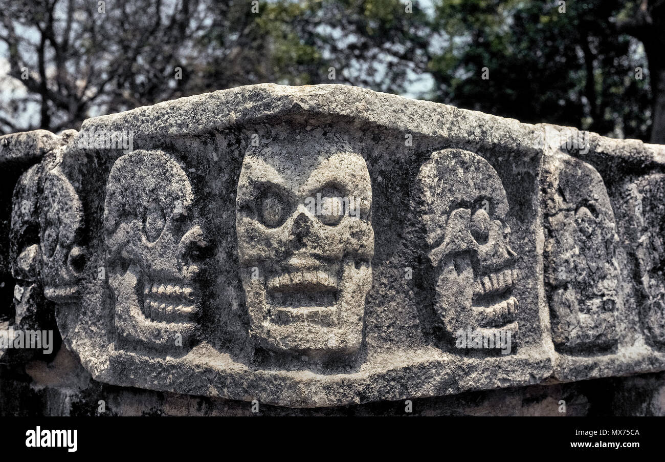 This is a close-up of the human skulls carved in stone by Mayans on