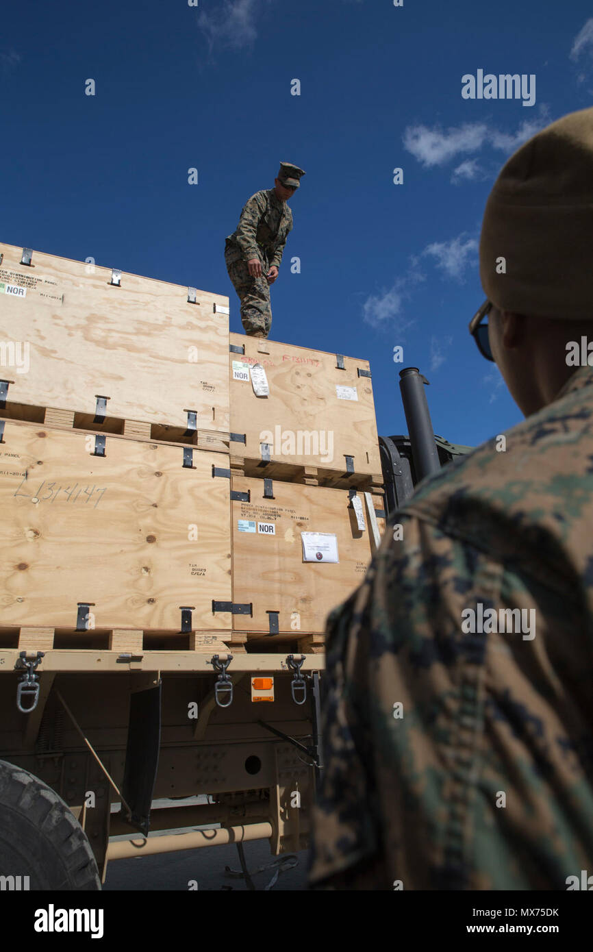 U.S. Marine Corps Cpl. Mohamed Hussain and Lance Cpl. Rodney Raber, motor vehicle operators with 2nd Transport Support Battalion, place boxes on a truck during Strategic Mobility Exercise 17 (STRATMOBEX) near Stjordal, Norway, May 2, 2017.  STRATMOBEX is a logistics-based exercise involving the preparation and movement of equipment from cave sites of the Marine Corps Prepositioning Program in Norway. Stock Photo