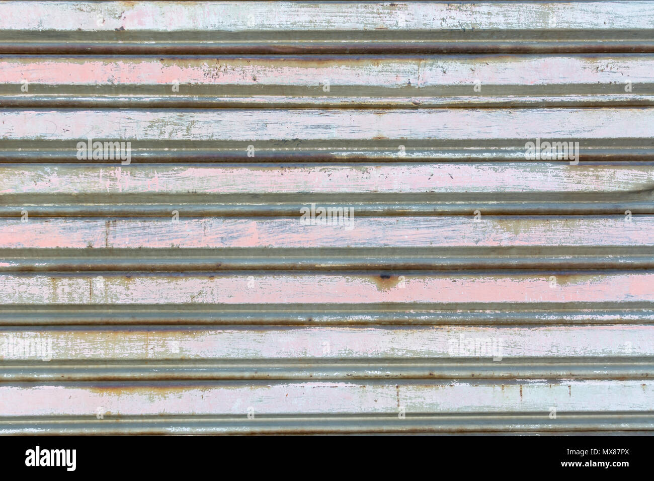 metal fence made of corrugated steel sheet with vertical guides - Stock Image