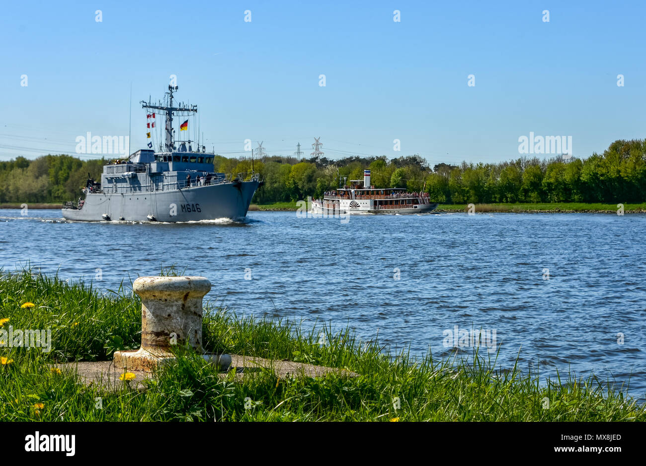 Ships in the canal. Different perspective and ship types. Passenger and container ships. - Stock Image