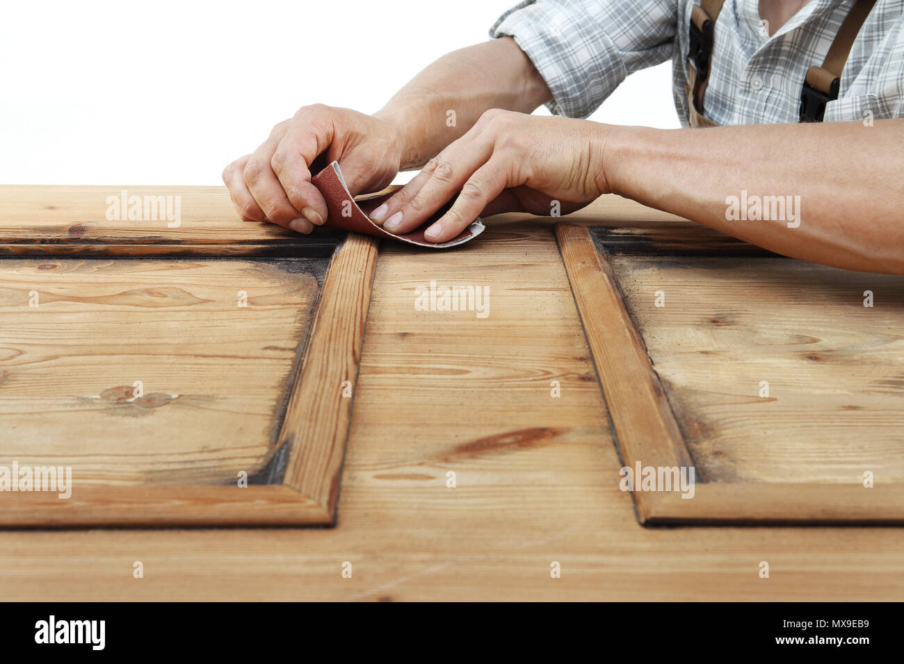 carpenter work the wood with the sandpaper - Stock Image