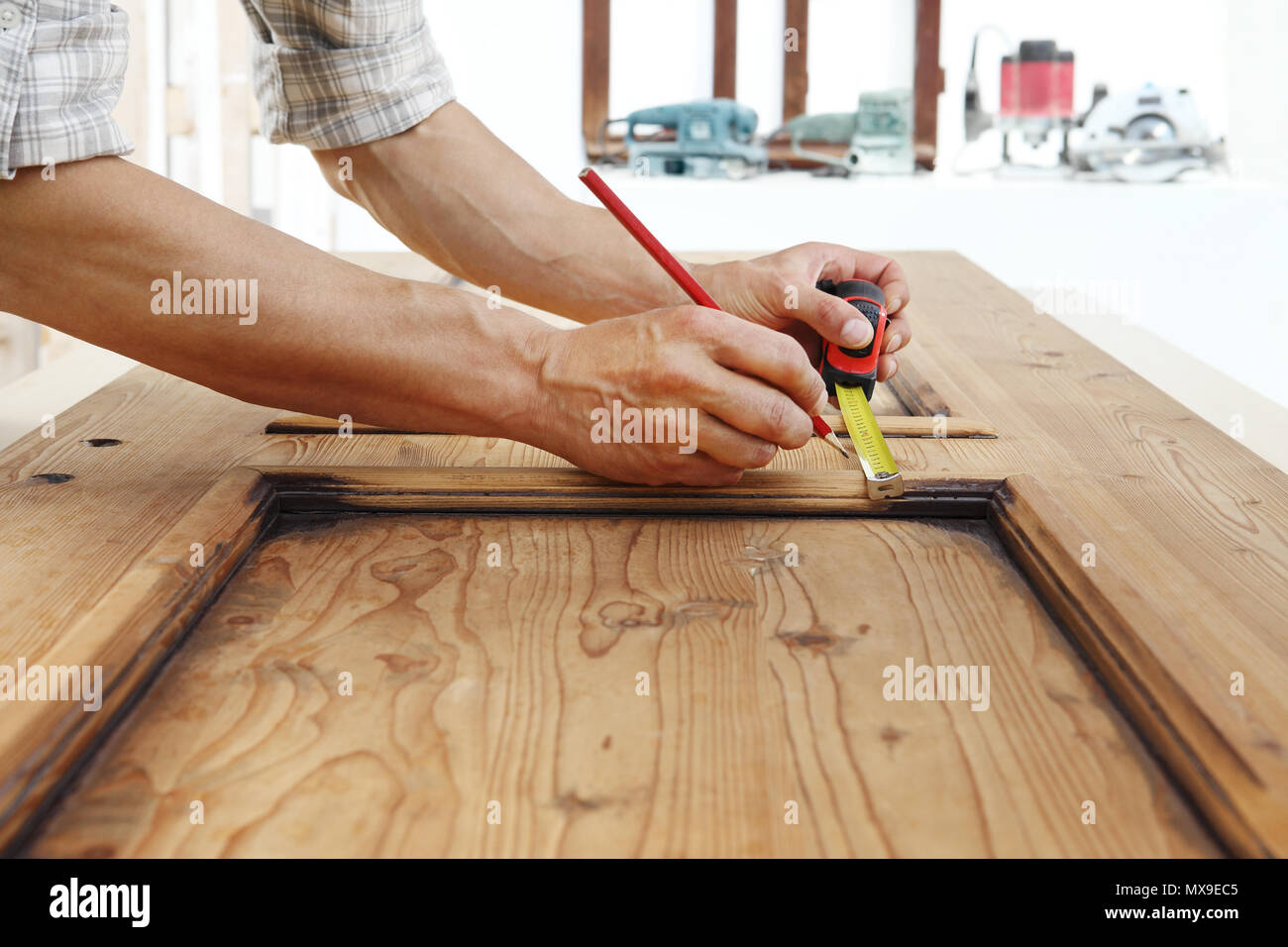 Carpenter Work The Wood Measuring A Wooden Vintage Door Stock Photo