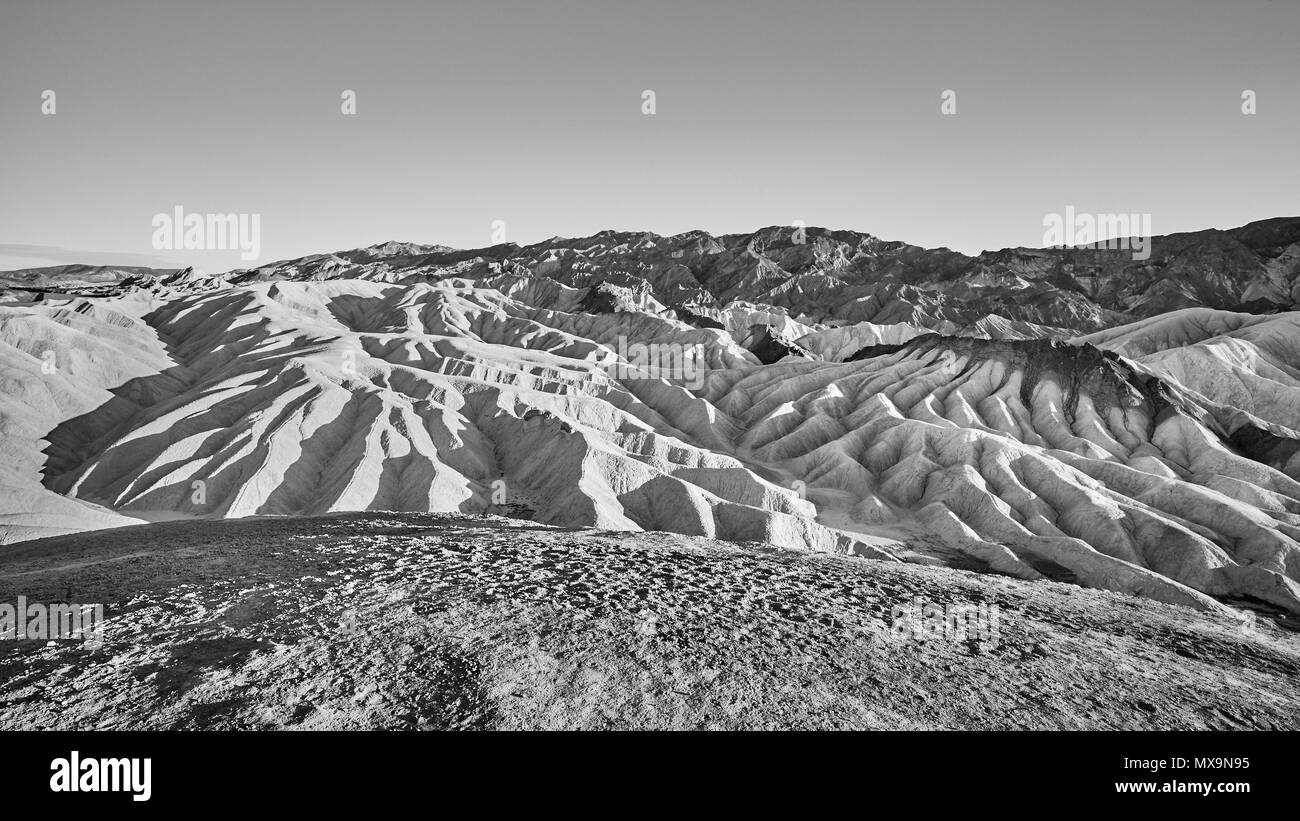 Black and white panoramic picture of Mars-like deserted land of the Death Valley, USA. - Stock Image