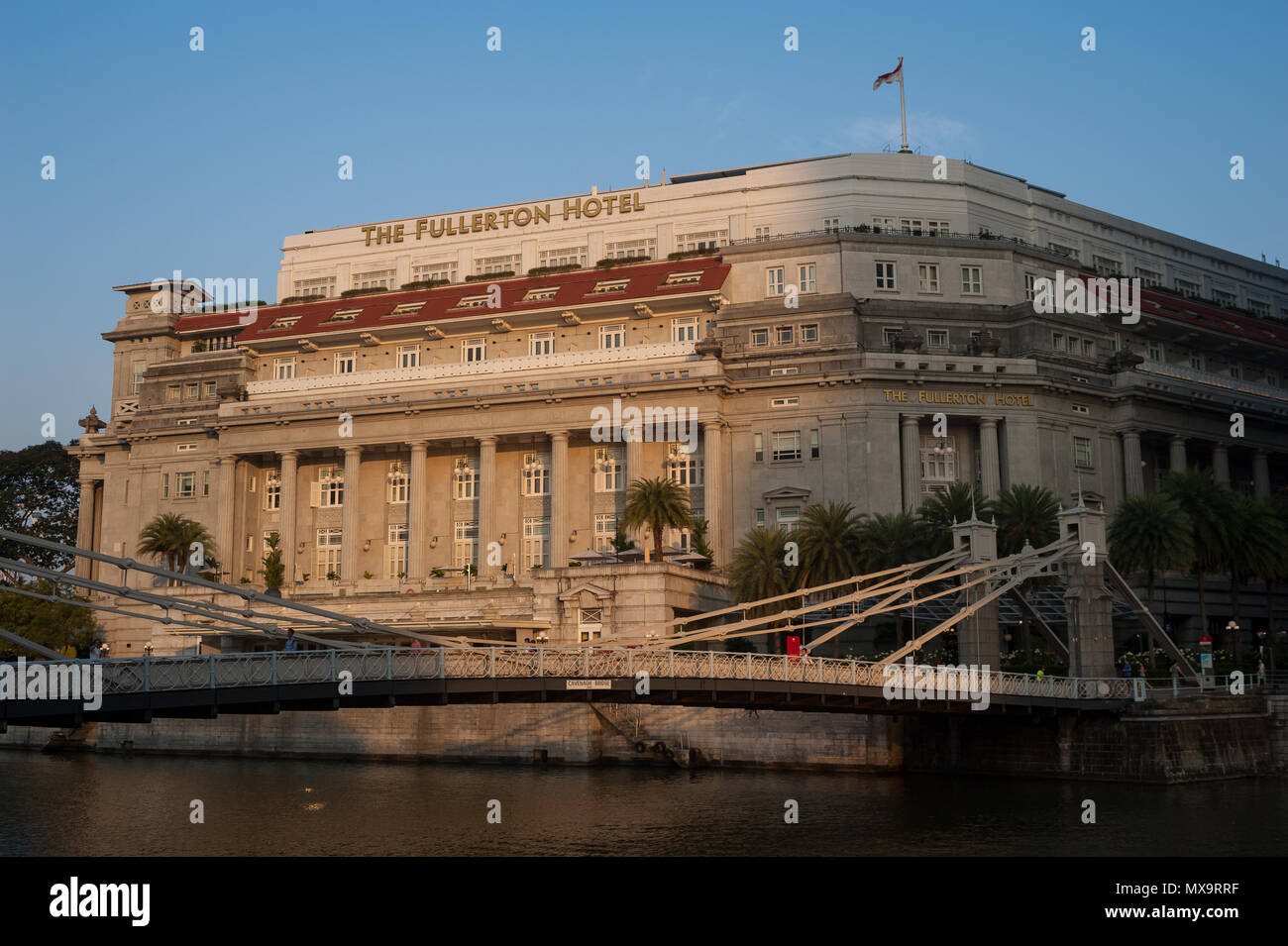 15.03.2018, Singapore, Republic of Singapore, Asia - A view of The Fullerton Hotel along the Singapore River in the lion city's downtown core. Stock Photo