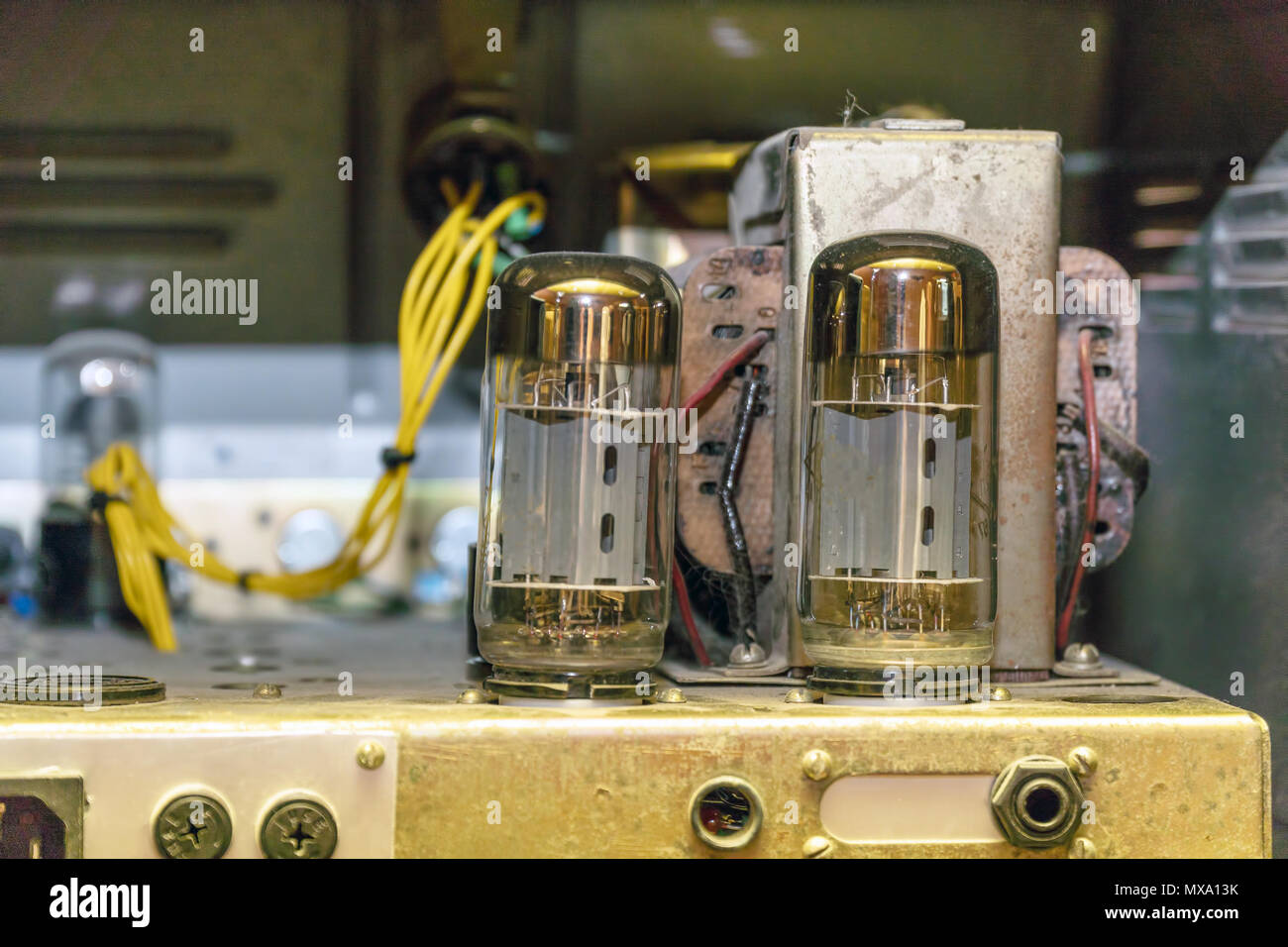 Radio tubes inside the old amplifier. Selective focus Stock Photo