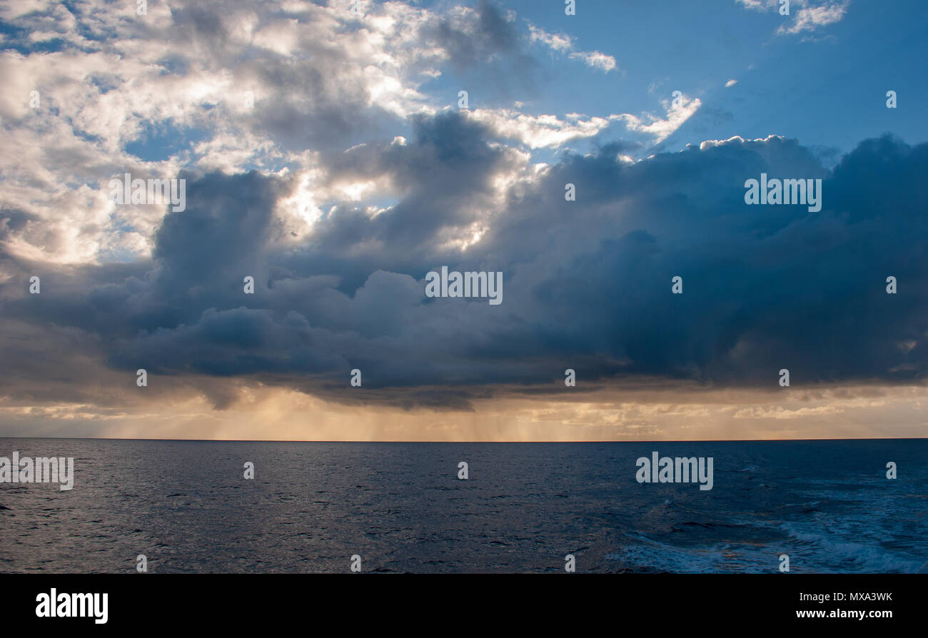 Mid atlantic seascape, clouds, rain, sunshine and blue sky all at once. May 2018 - Stock Image