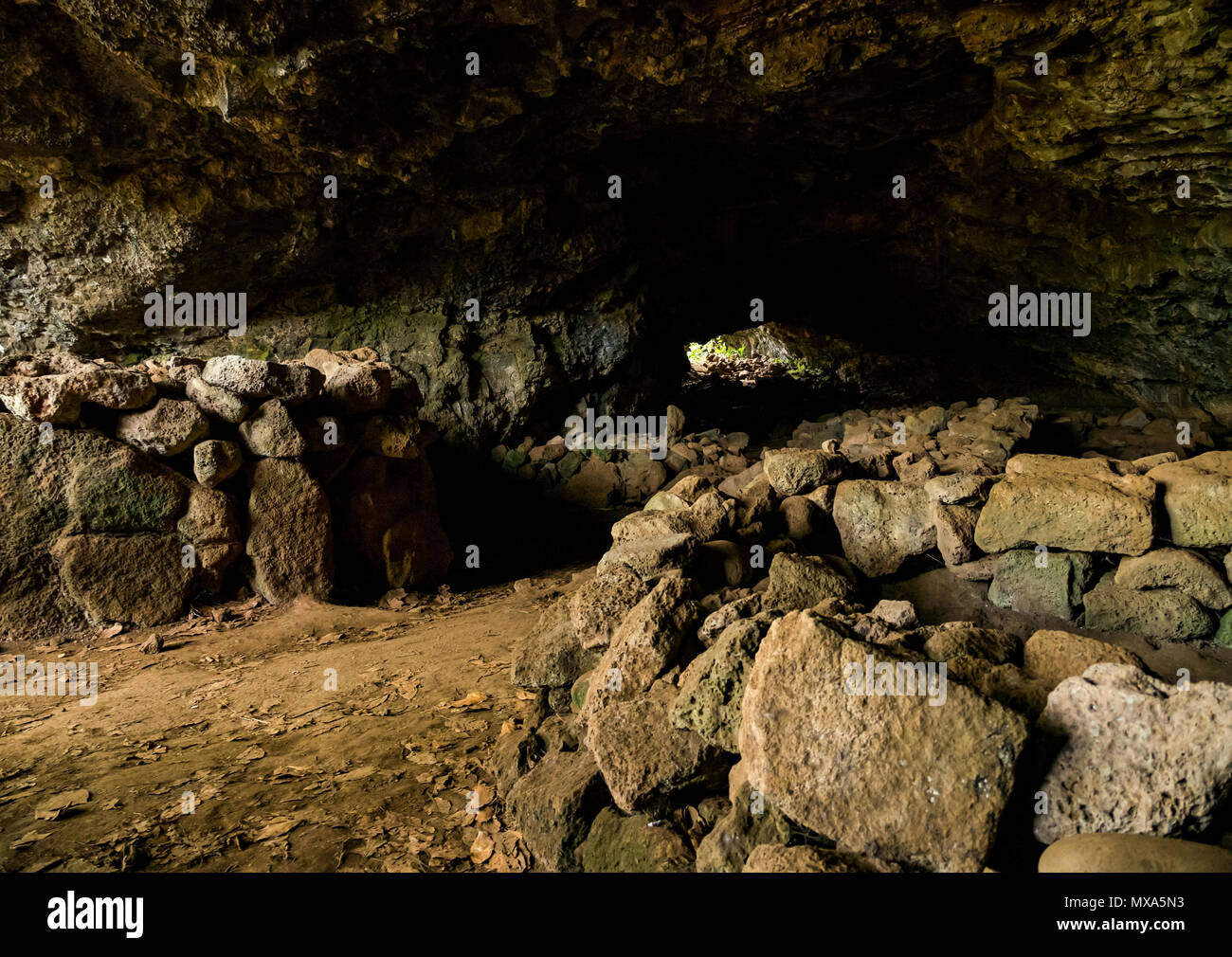 Ana Te Pahu lava tube cave, Easter Island, Rapa Nui, Chile, with manavai for growing produce and used by ancient people as dwelling place - Stock Image
