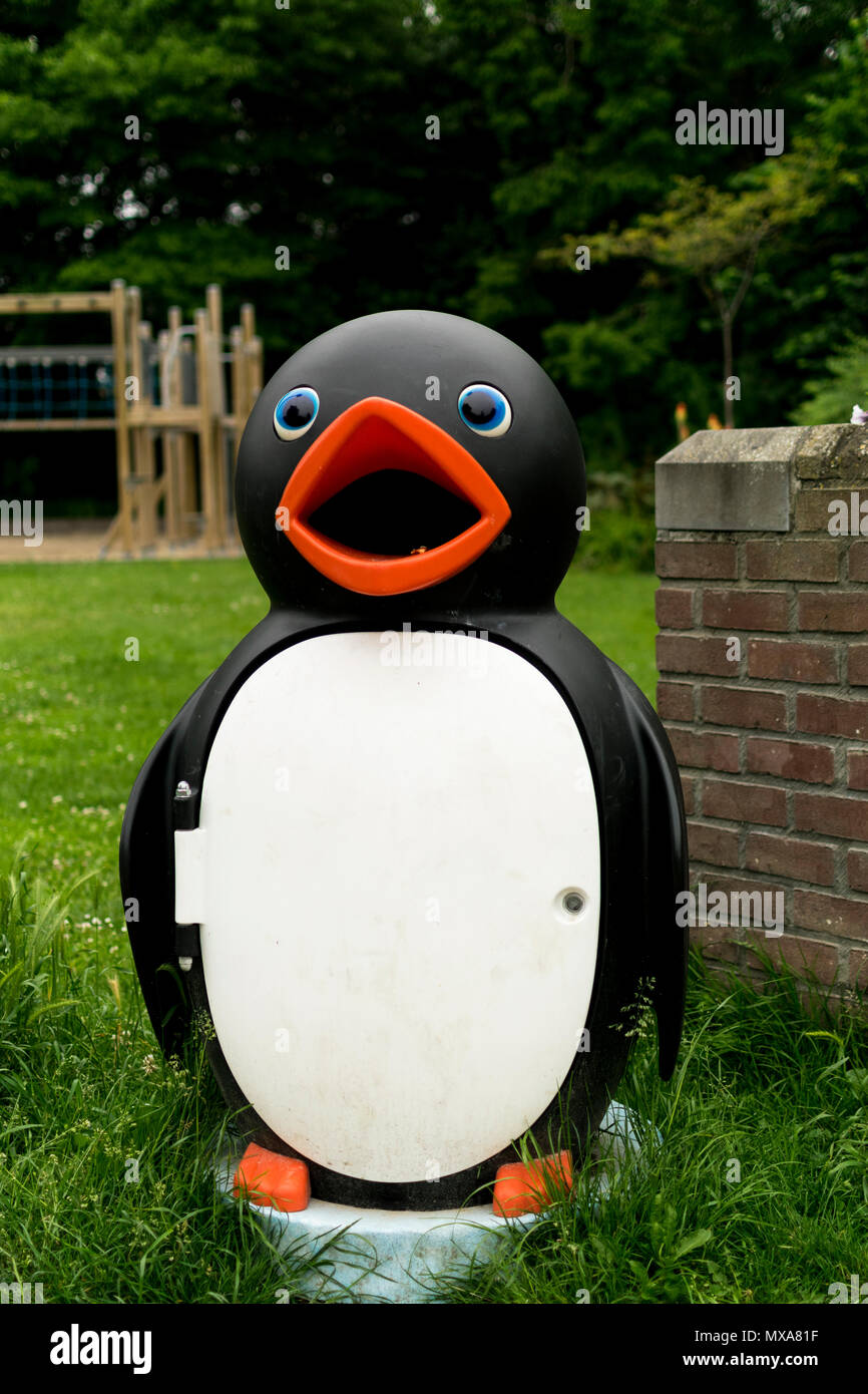 Childfriendly public penguin trash can in Roeselare, Geite park Stock Photo