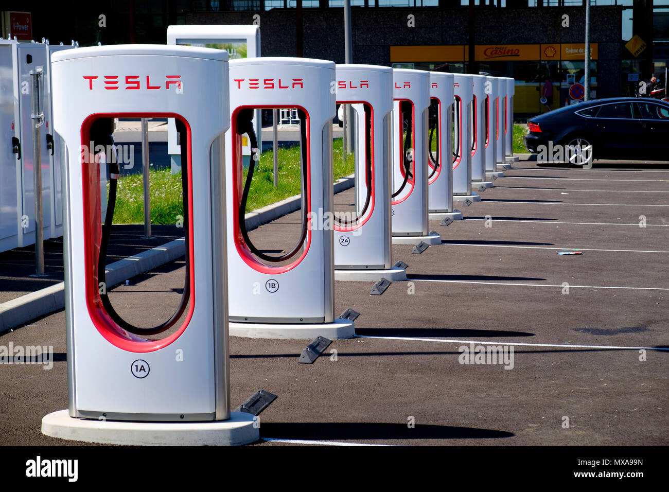 Tesla multi electric car charging points at French service station - Stock Image