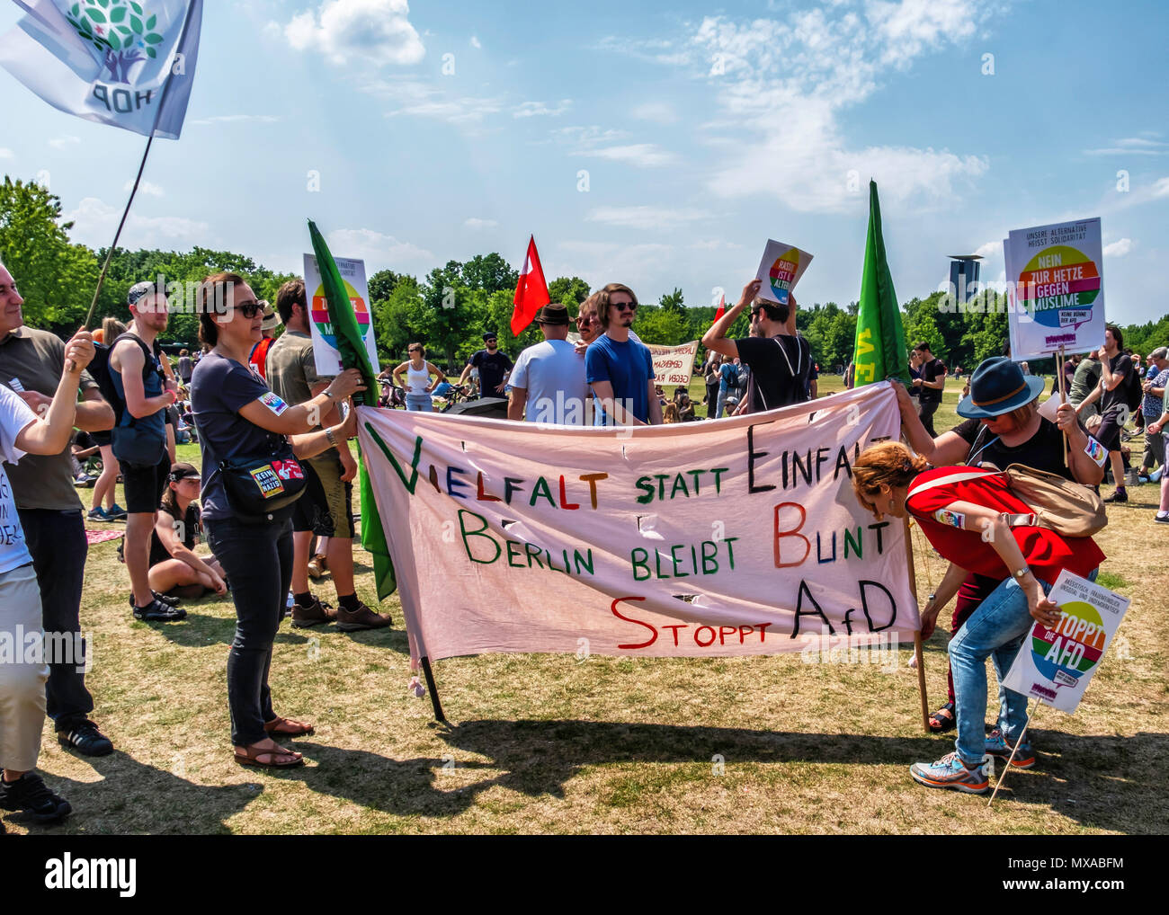 Berlin Mitte Anti AfD protesters. People with Banners challenge the anti-immigration right wingers - Stock Image