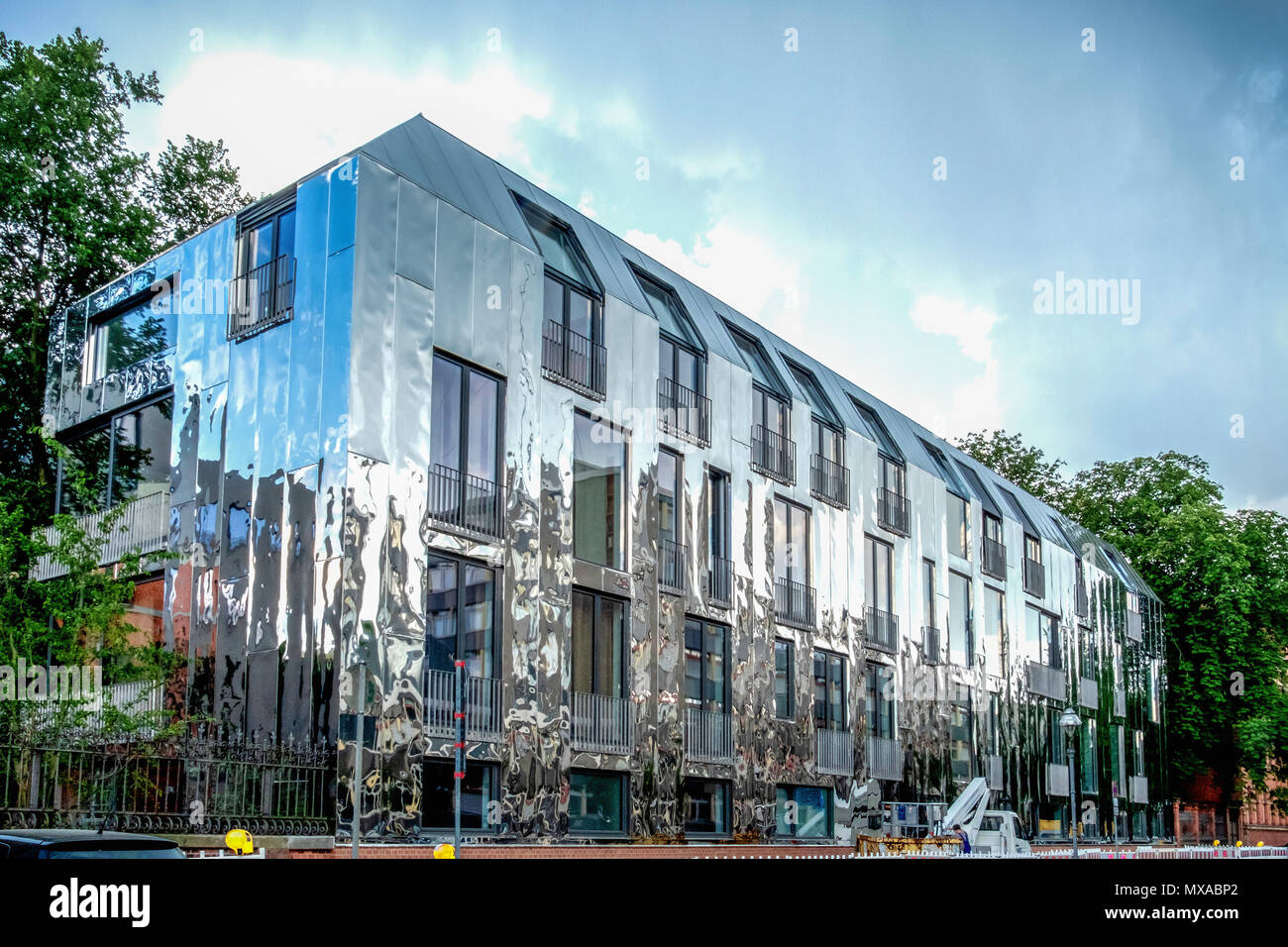 Berlin Moabit Sauerbruch Hutton Haus 6 . View of shiny new mirrored ...