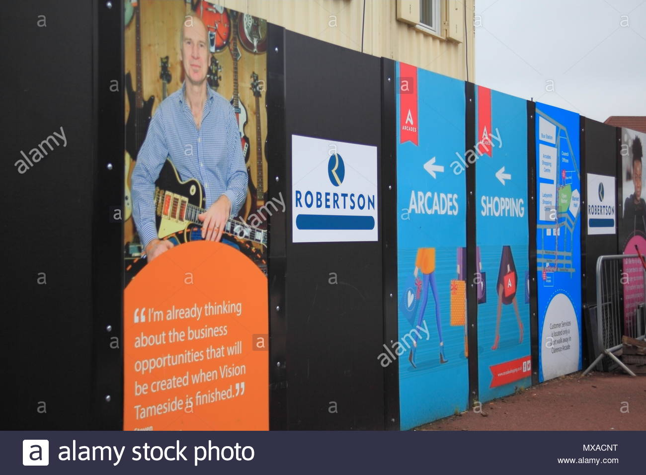 Advertisement Boarding Of Joint Public Service Centre For The Vision Tameside Project At Wellington Street Ashton-Under-Lyne Tameside June 2018 - Stock Image