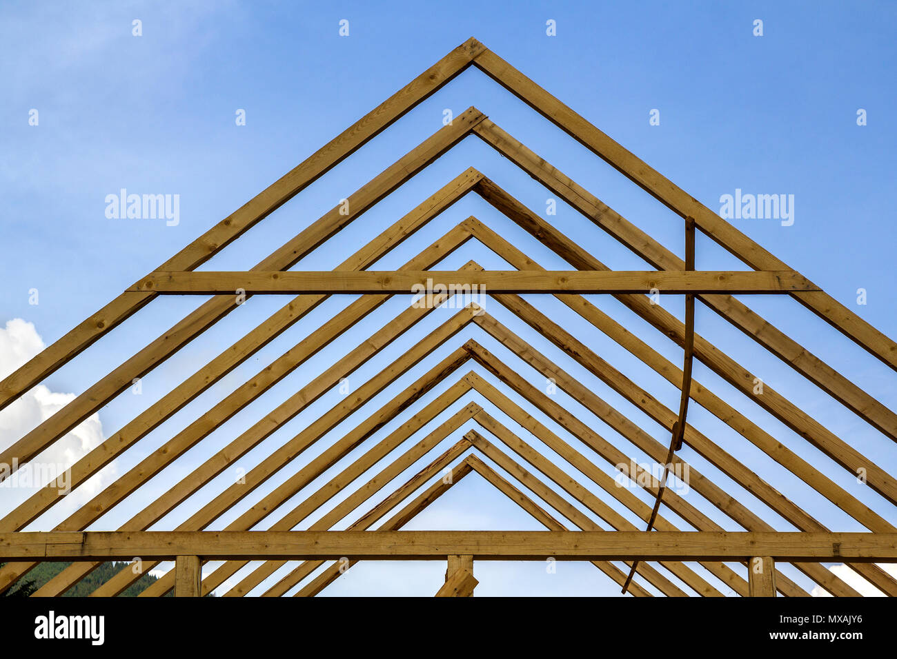 Close-up detail of wooden high steep roof framing under