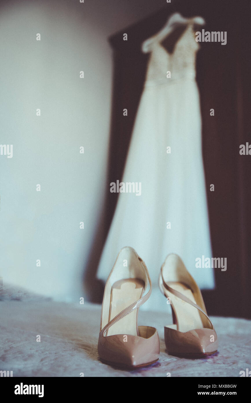 Wedding dress and wedding shoes on the bed Stock Photo: 188335305 ...