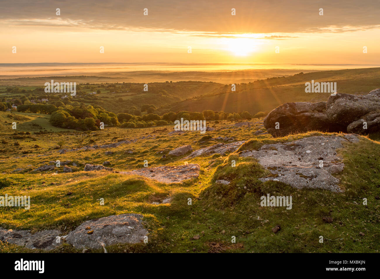 A beautiful Sunday morning June sunrise over the village of Belstone on Dartmoor - Stock Image
