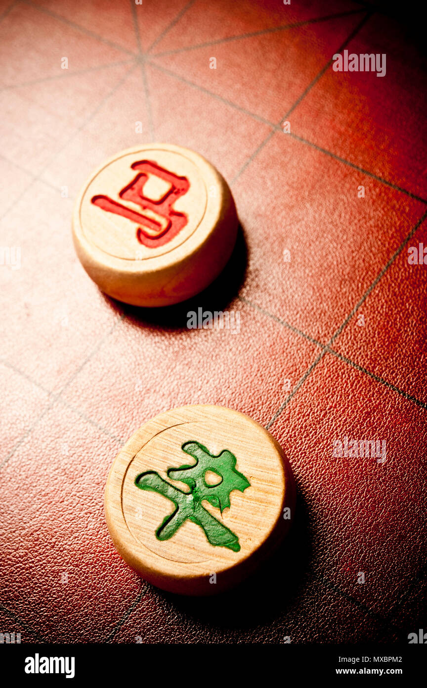 close up of  Chinese chess or Xiangqi pieces on the chessboard - Stock Image