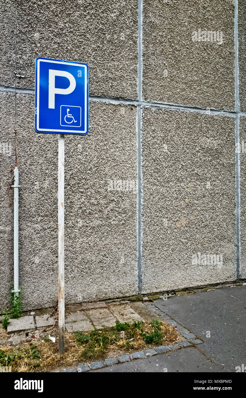 wall and disabled parking sign - Stock Image
