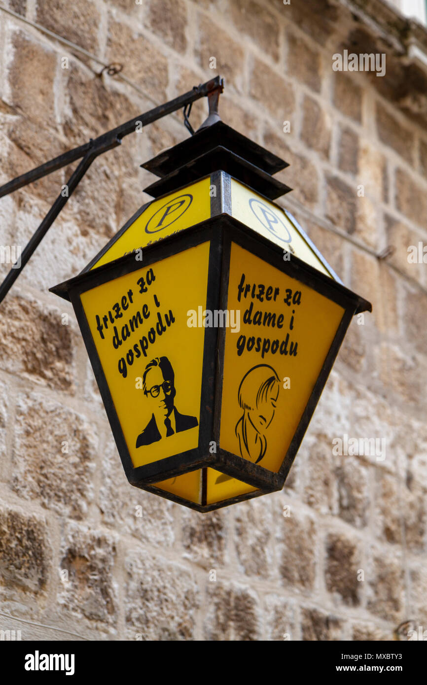 Lamp outside the frizer za dame i gospodu restaurant hop in the Old City of Dubrovnik, Croatia. - Stock Image