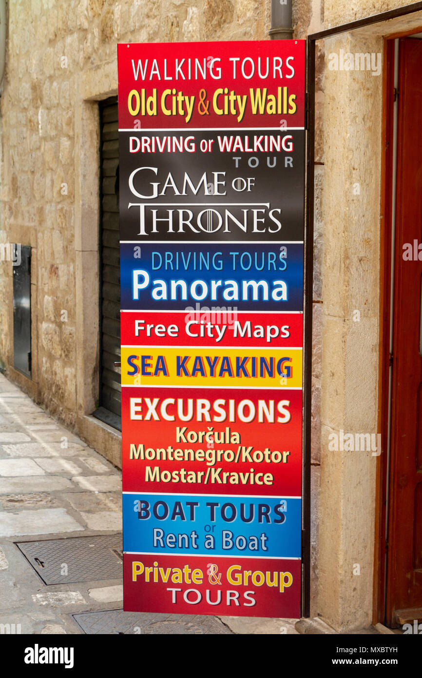 Typical notice advertising activities available to tourists outside a shop in the Old City of Dubrovnik, Croatia. - Stock Image