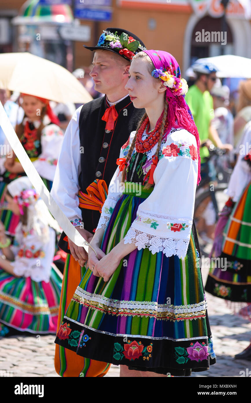 Lowicz / Poland - May 31.2018: View of a couple, man and woman dressed in a colorful folklore, regional costume during Corpus Christi Celebration. Stock Photo