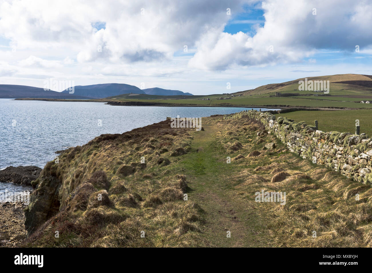 St Magnus Way footpath ORPHIR ORKNEY Foot path trail Scapa Flow cliff shore Finstown to Earl Hakons Round Kirk - Stock Image