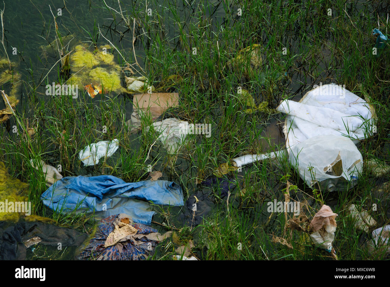 Top view of dirty waters by garbage. Ecological industry concept - Stock Image