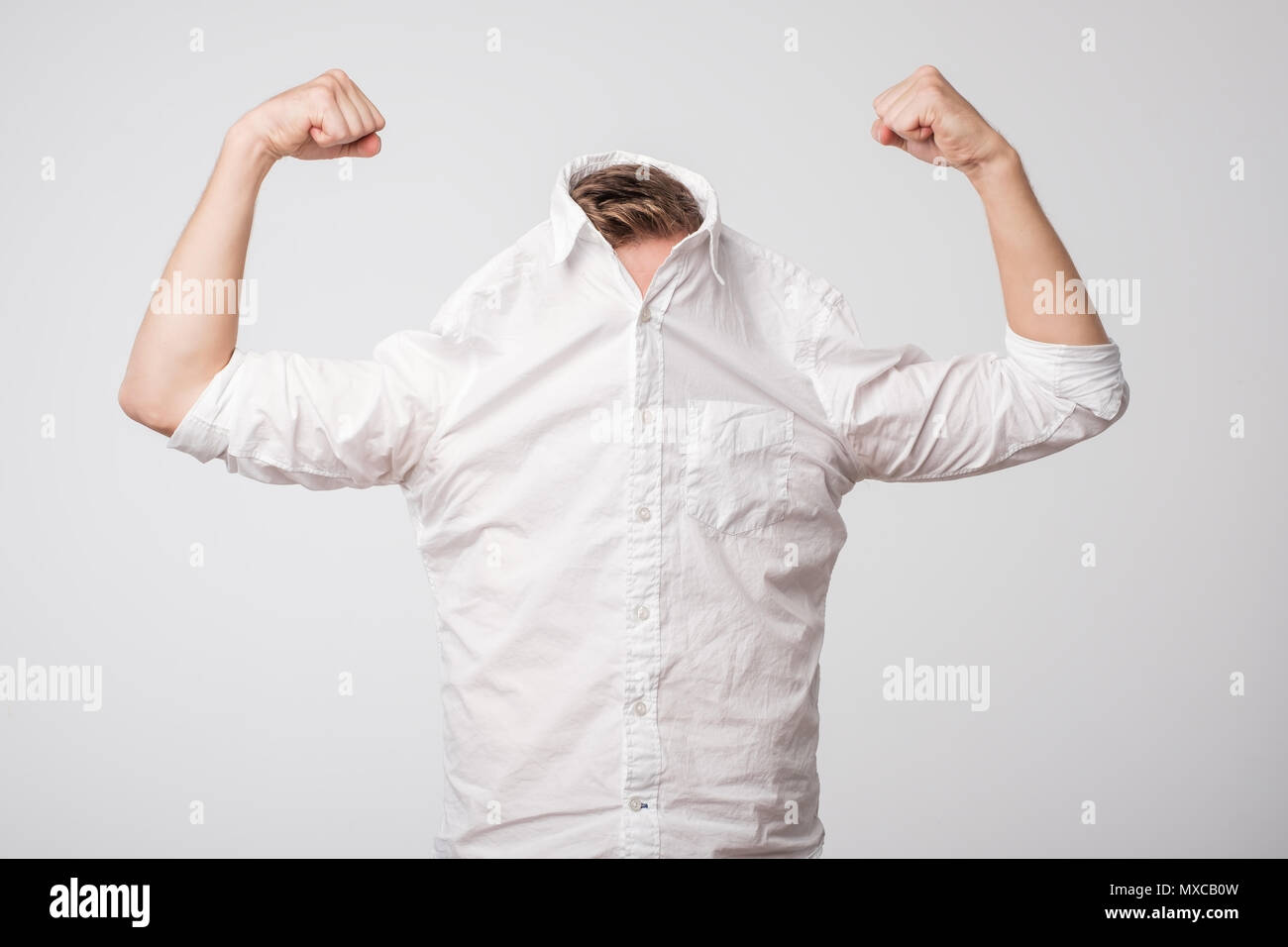 Portrait of a modern handsome man showing his power. - Stock Image