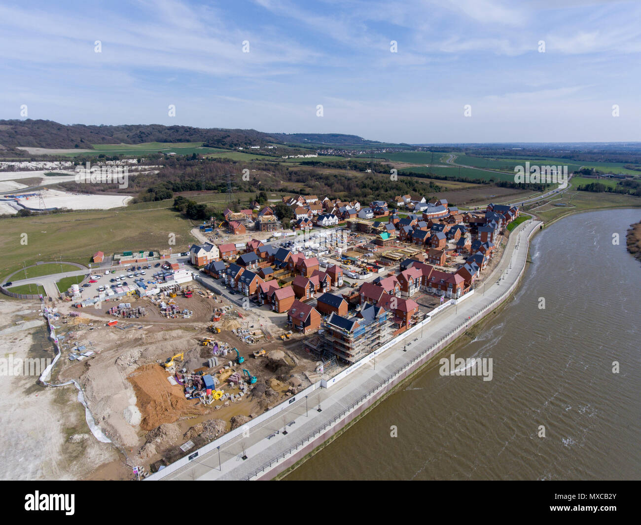 The newly created Peters Village, still under construction, on the bank of the Medway in Kent, England - Stock Image