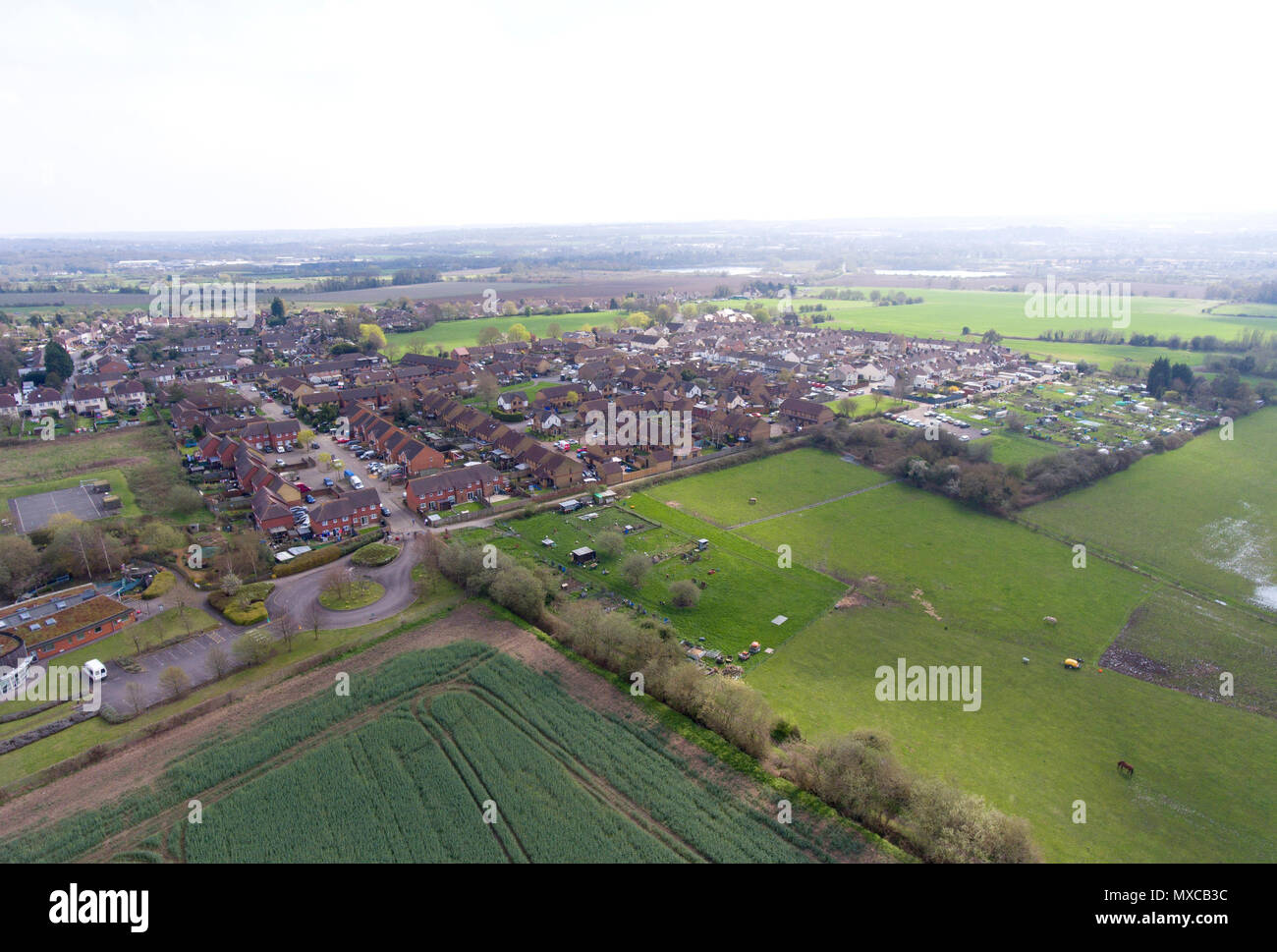 Aerial view of Eccles village near Aylesford in Mid Kent, UK. St Marks school bottom left and allotment gardens mid right - Stock Image