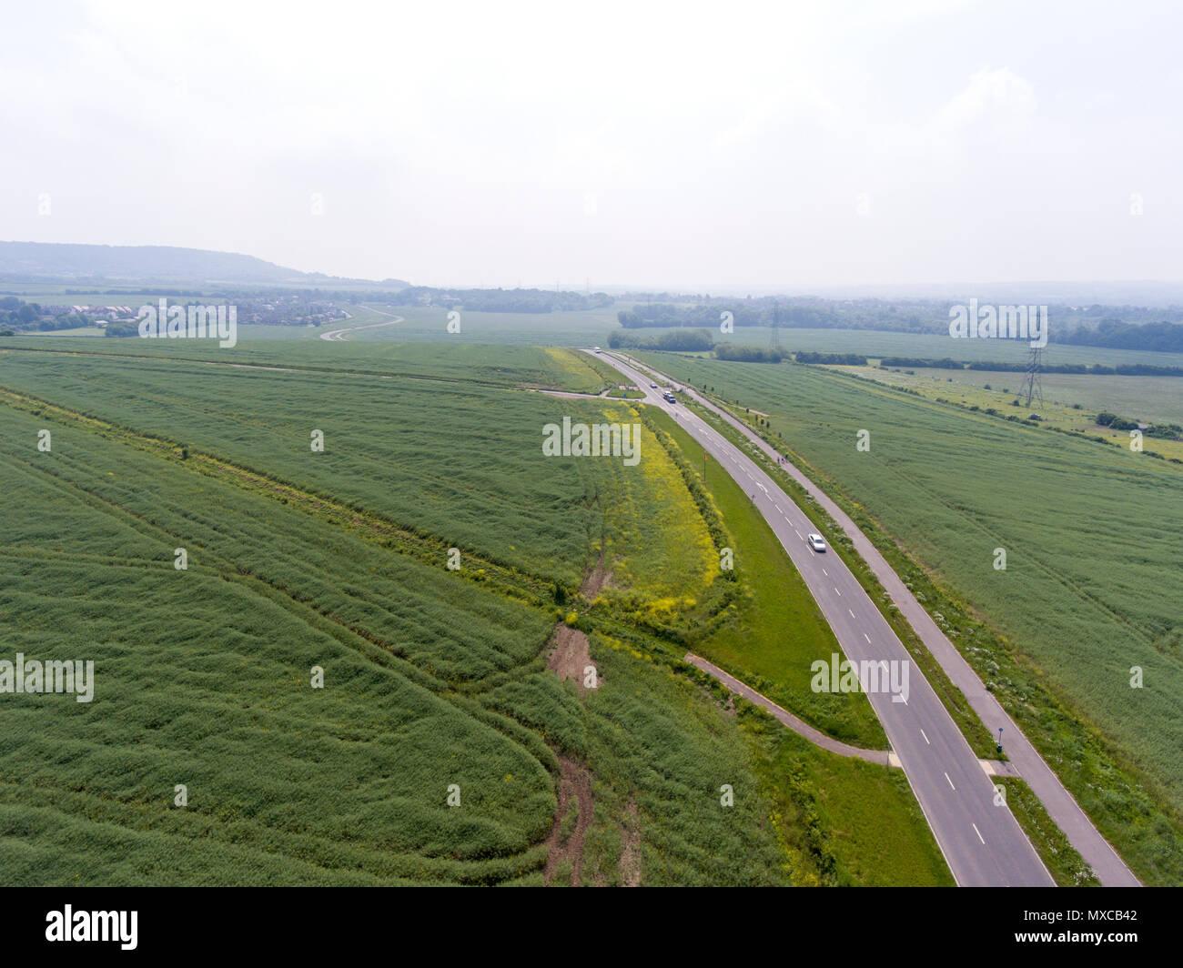 Country lane through fields, Kent, UK - Stock Image