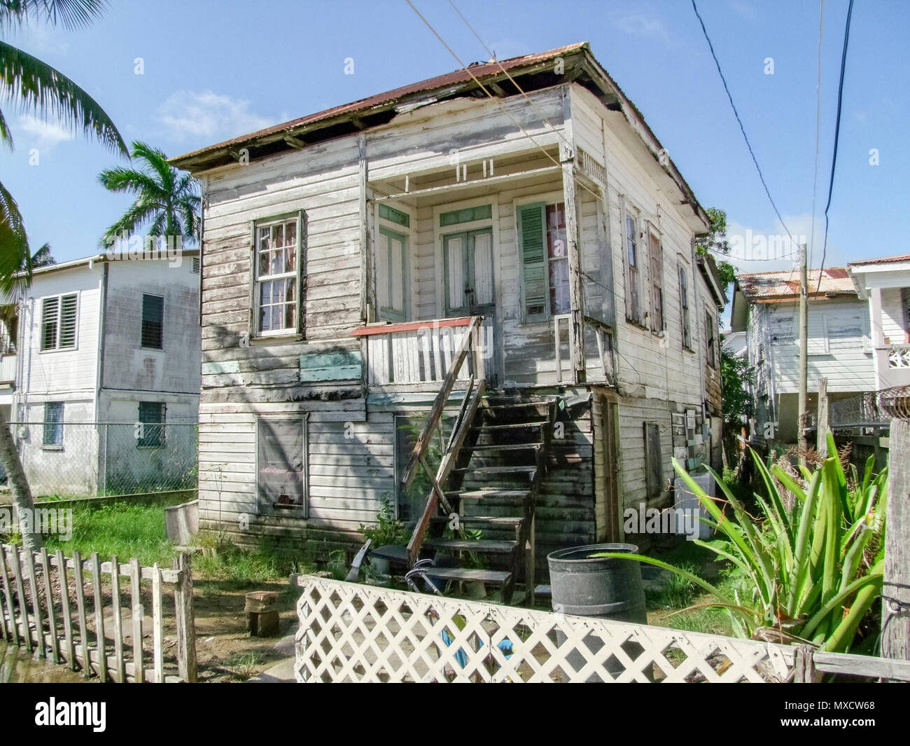 rundown wooden        house seen in Belize City, the capital of Belize in Central America - Stock Image