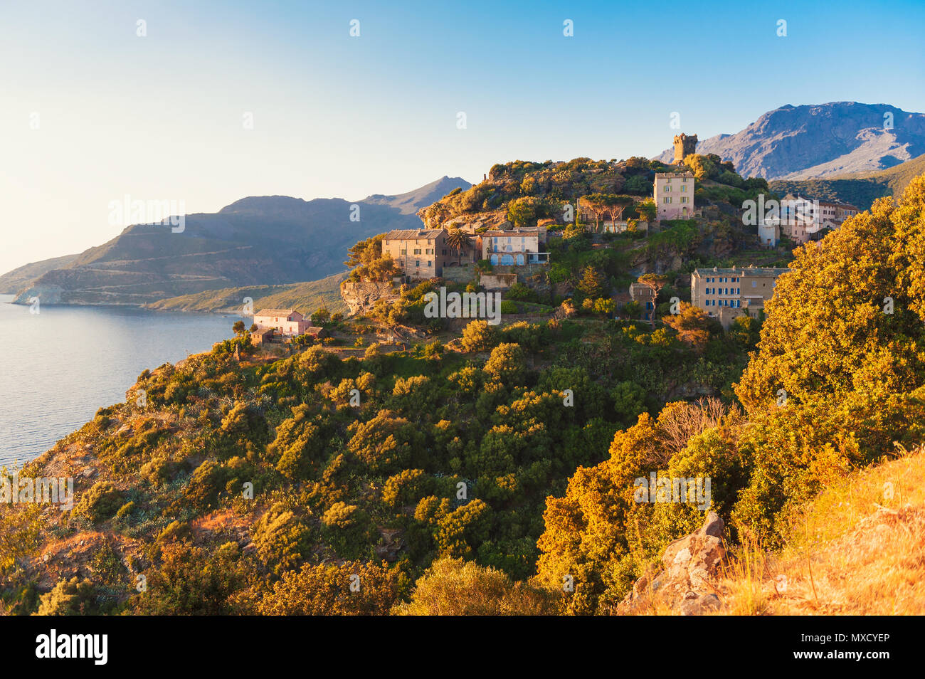 Village of Nonza, Corsica, France at sunset - Stock Image