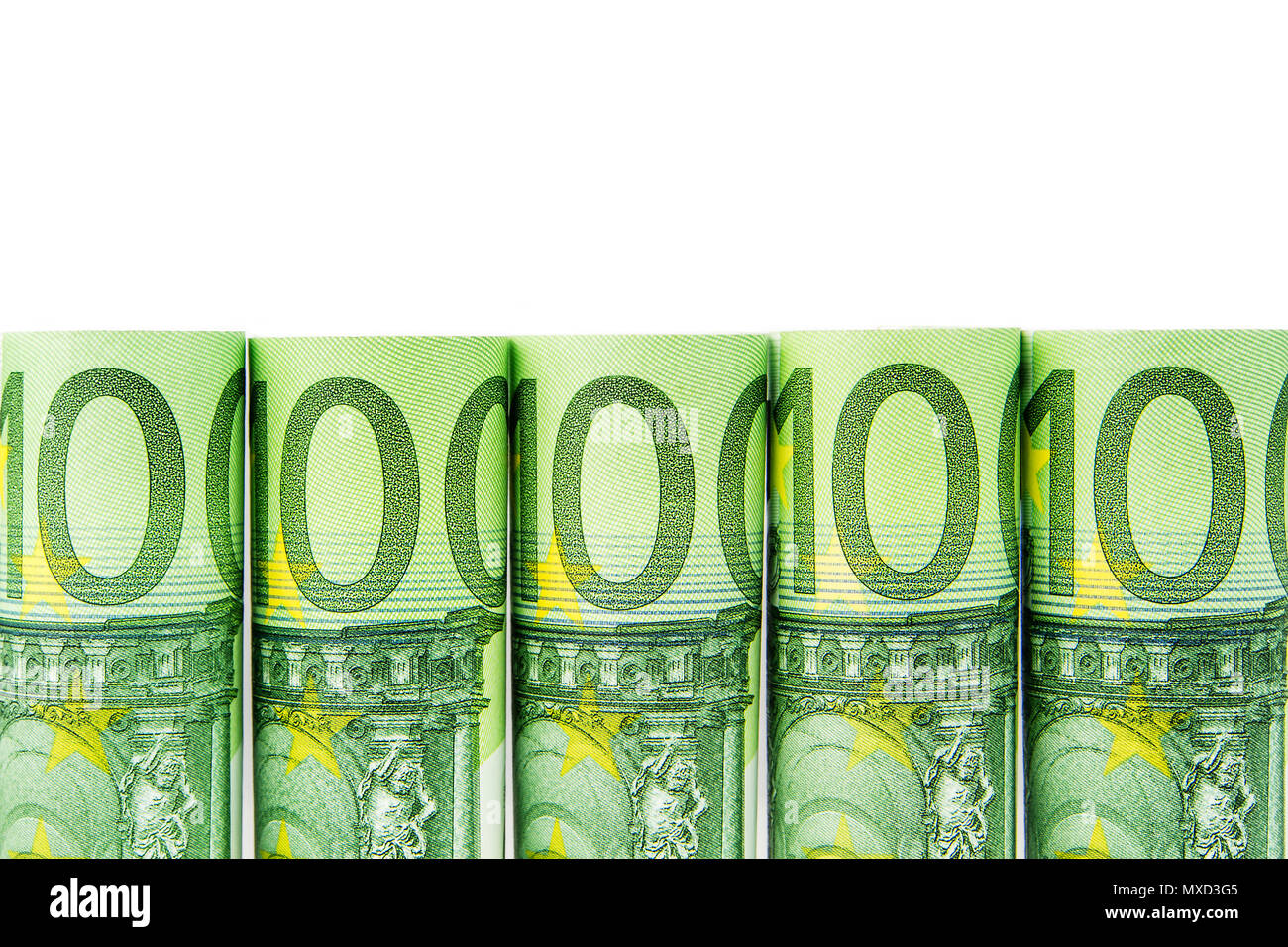 five one hundred euro banknote rolls in one row on white background - Stock Image