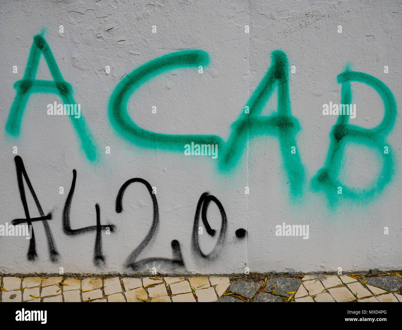A graffiti reading  ACAB, acronym for 'All cops are bastards', Almada district, Lisbon, Portugal - Stock Image