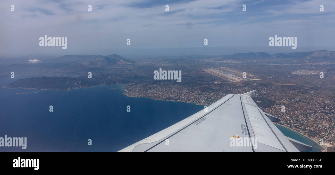 Plane approaching Athens, Greece airport. View out of airplane window. Stock Photo