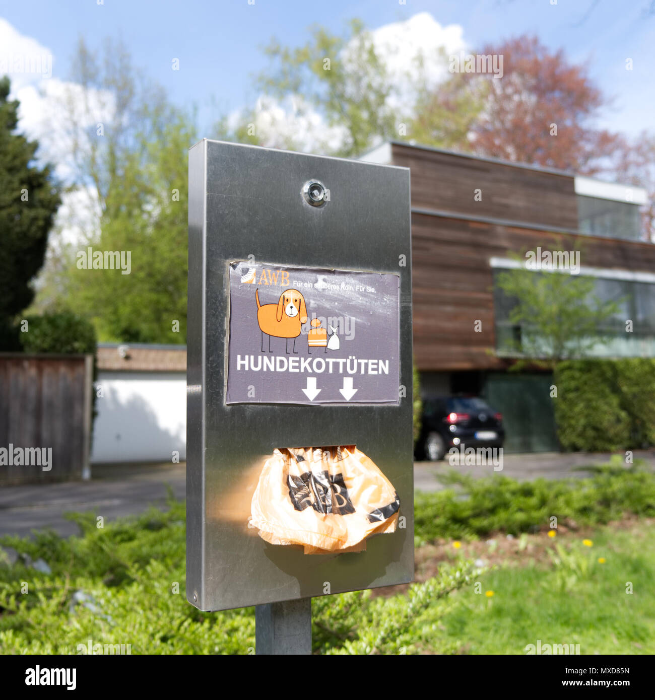 Container for dog biscuits. Spender für Hundekotttüten der Stadt Köln - Stock Image