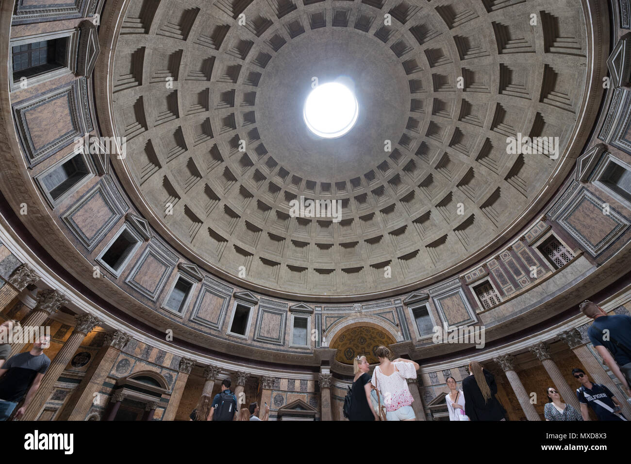 Rome Pantheon interior, light true the hole, tourists visiting Stock Photo