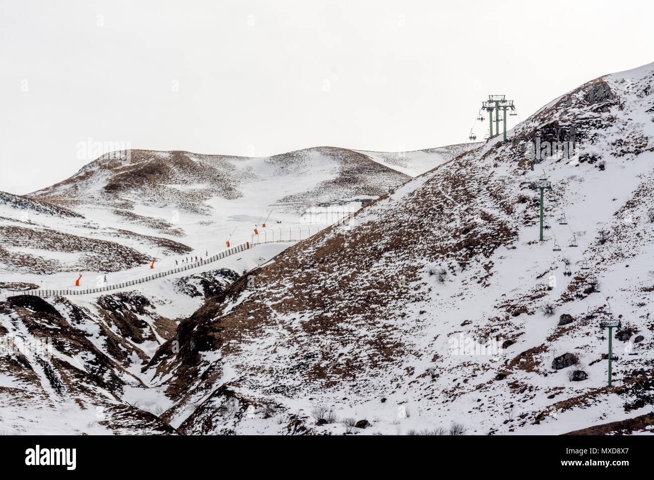 Chairlifts. Le Mont Dore ski resort, Auvergne, France - Stock Image