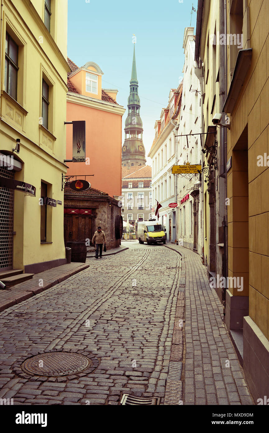 Riga, Latvia. Narrow medieval cobbled Kramu iela street with tenement houses in the old town of Riga. Retro vintage style. - Stock Image