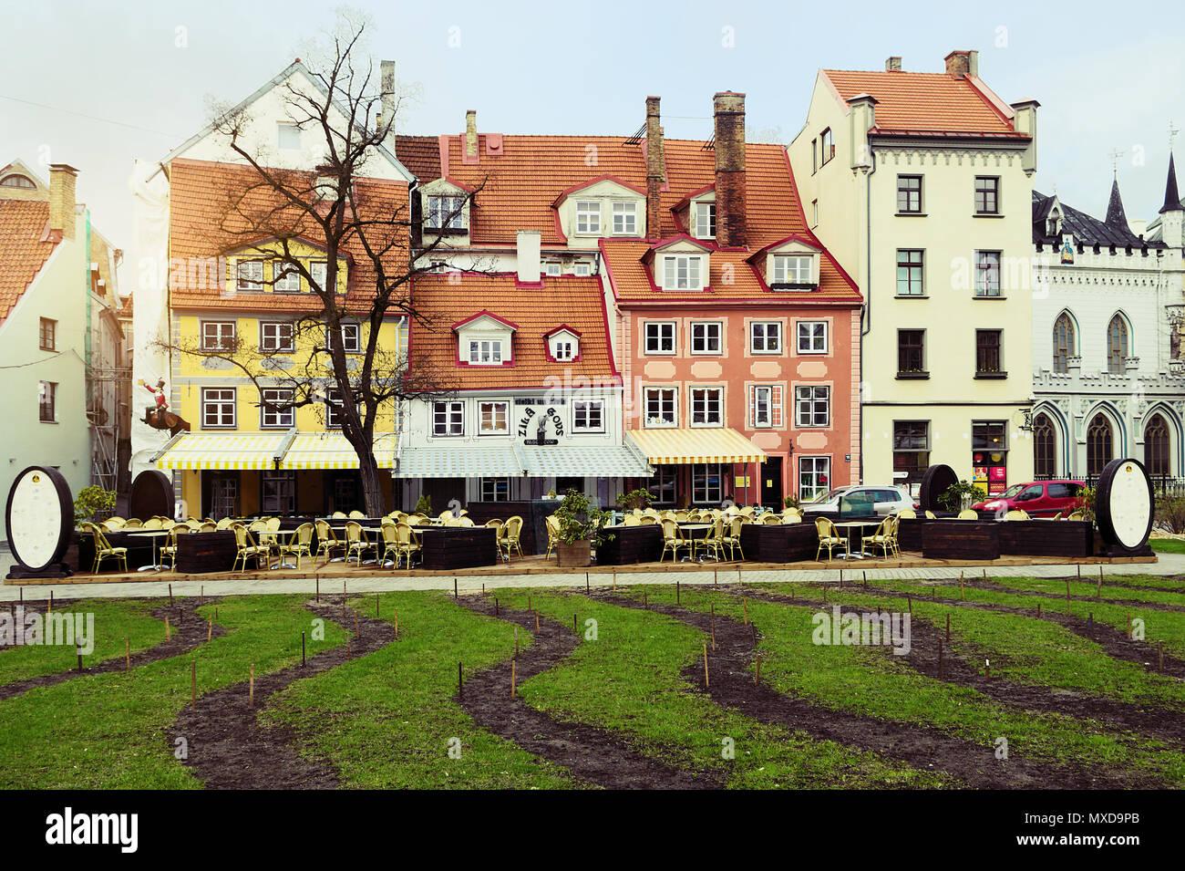 Riga, Latvia. Livu laukums square with colorful townhouses on Meistaru iela street. Old town of Riga. - Stock Image