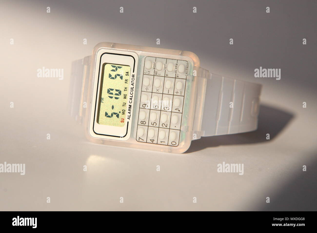 Calculator Watch Stock Photos Images Alamy Circuitry Of An Electronic Royalty Free Photography A Retro Style Digital With In Clear Plastic Strap Image
