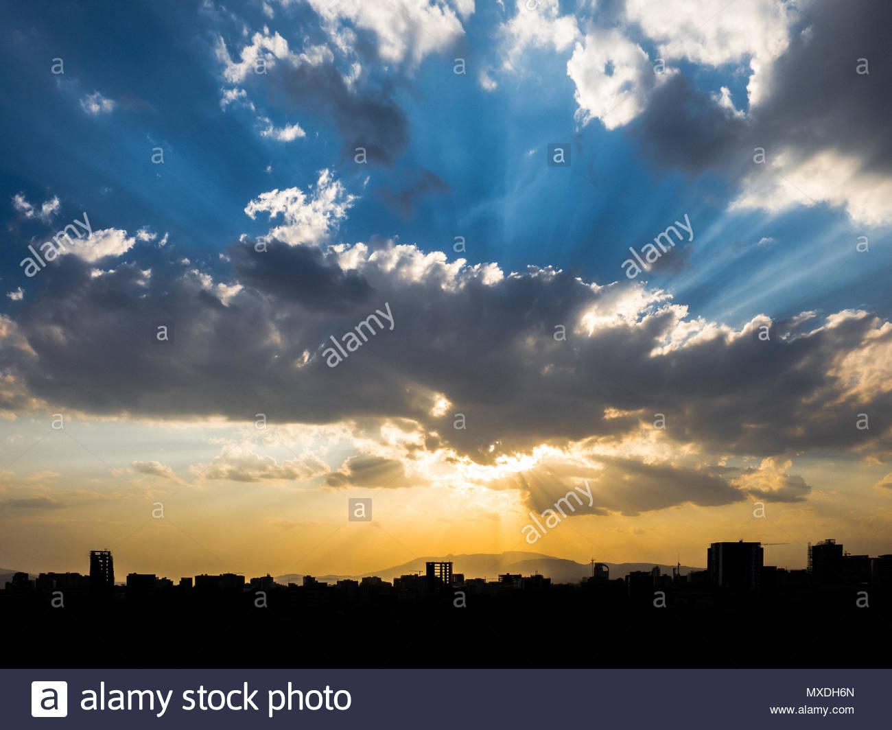 A sunburst above teh skyline of Addis Ababa, Ethiopia, at sunset. Stock Photo